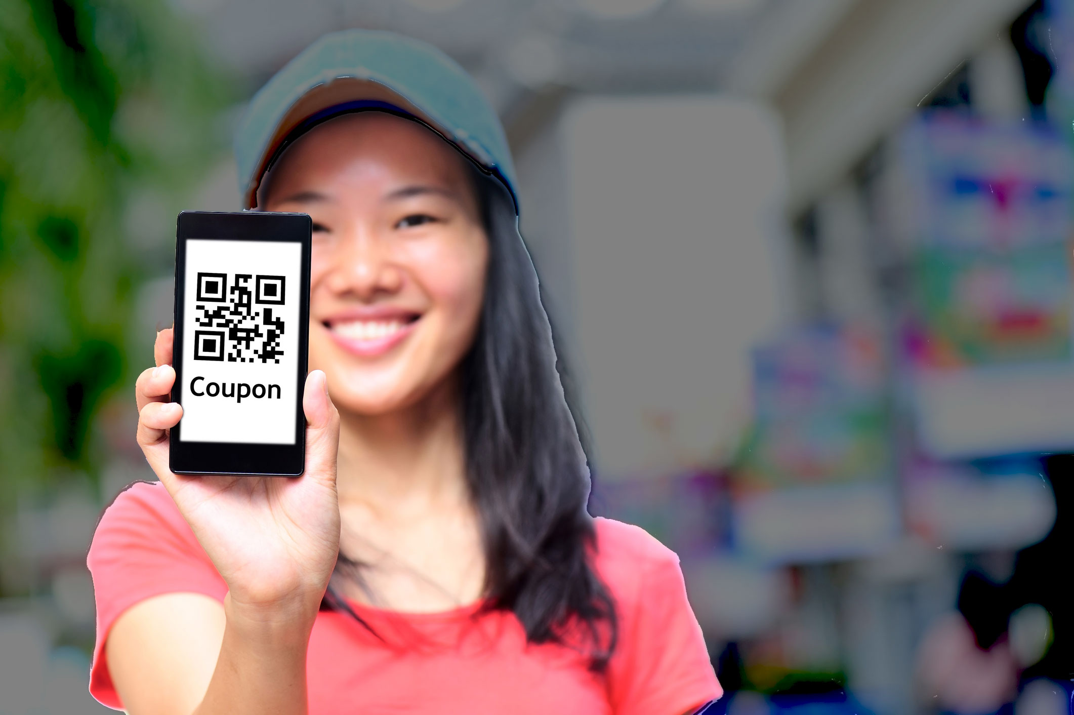 girl showing mobile coupon